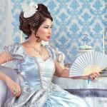 Beautiful asian woman sitting with a fan